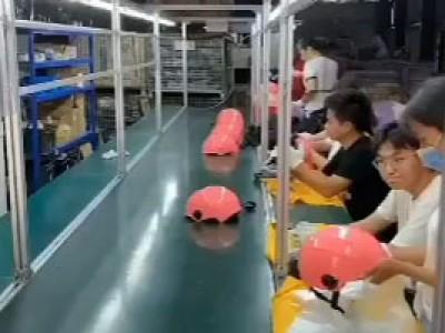 流水线输送机应用于头盔生产
