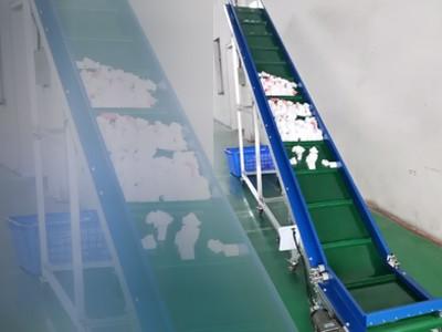 爬坡型皮带输送机应用于泡沫棉废料输送